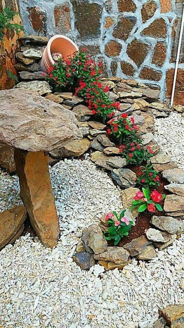 διακόσμηση στον κήπο με πέτρες και πυθάρια12
