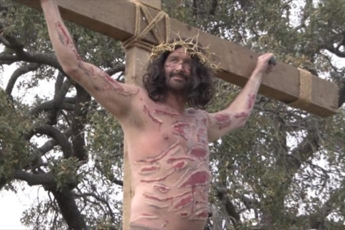 Man hangs from Cross _5627190785716273540