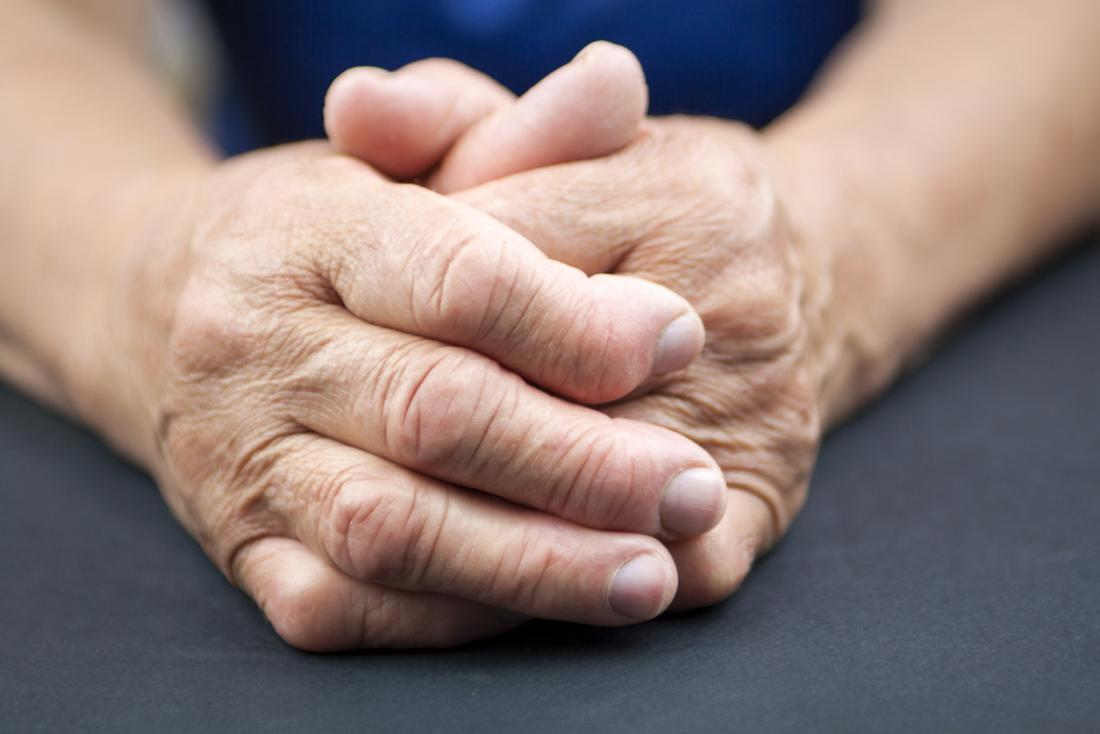 rheumatoid-arthritis-in-senior-persons-clasped-hands_1551823518152.jpg