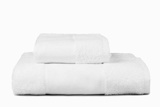 Stack of embroidery towels, white