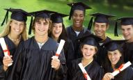 Smiling Graduates with Diplomas --- Image by © Royalty-Free/Corbis