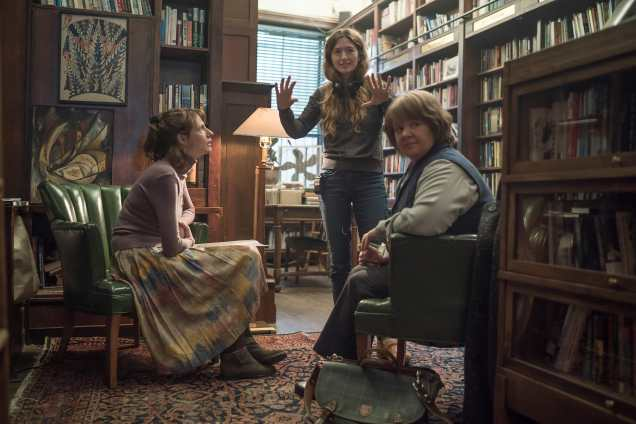 (From L-R): Dolly Wells, Director Marielle Heller, and Melissa McCarthy on the set of CAN YOU EVER FORGIVE ME? Photo by Mary Cybulski. © 2018 Twentieth Century Fox Film Corporation All Rights Reserved