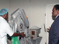 Breaking the Ice Rodney Solomon (left) demonstrates an ice maker machine to Chief Secretary Orville London at the Tobago Cold Storage Facility. & Re-commissioning of the Tobago Cold Storage and Warehouse Facility ...