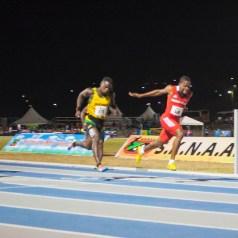 Akanni Hislop wins his heat en route to Boys Under-18 100 metres silver.