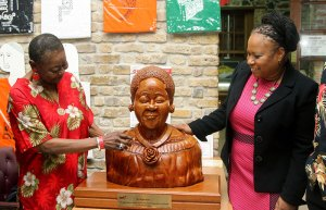 Calypso Rose and Secretary of the Division of Community Development and Culture Dr Denise Tsoiafatt-Angus admire the donated sculpture.