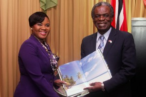 Chief Secretary Orville London and Minister of Tourism Shamfa Cudjoe, MP, exchange gifts during their meeting on Monday. Photos courtesy THA