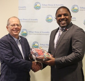Taste of Tobago: Secretary of Finance and Enterprise Development, Assemblyman Joel Jack presents a gift basket of products made by local entrepreneurs to Canada's High Commissioner to Trinidad and Tobago, His Excellency Gerard Latulippe after the opening ceremony of the Public Private Partnership Workshop at the Victor E. Bruce Financial Complex on 23rd March, 2016.
