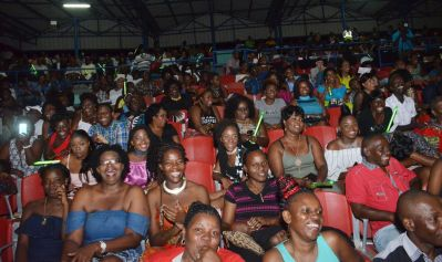 Audience members enjoy the talent and performances during the competition.