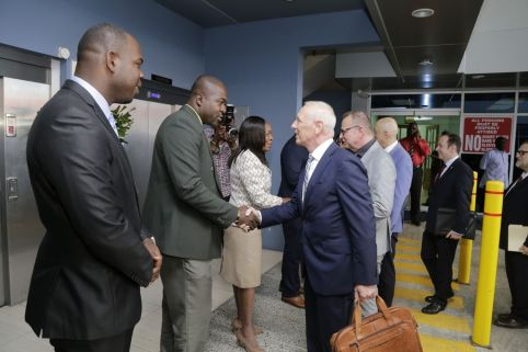 Leader of the European Union Delegation to Trinidad and Tobago Aad Biesebroek, centre, is greeted by Settlements Secretary Clarence Jacob, second from left, on their arrival at the Community Development Division. Standing from left are Assistant Secretary of the Community Development Division Shomari Hector, Community Development Secretary Marslyn Melville-Jack, and other members of the EU delegation.