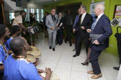 Members of the European Union Delegation enjoy the rhythms of drums and steelpan, played by the Heartbeat Folk Orchestra, who serenaded them at the Division of Tourism, Culture and Transportation.