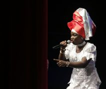 "Tied for second place, Wendy Garrick sings ""Fly Trinbago""."
