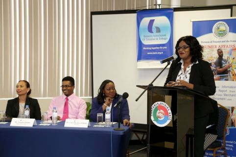 Consumer Liaison Officer in the Consumer Affairs Unit of the Division of Finance and the Economy Verdine Williams speaks on consumer rights and trust at the World Consumer Rights Day programme. At the head table, from left, are Scotiabank's Regional Senior Manager of Investigations and Loss Prevention Jennifer Koo-Rogers, Consumer Affairs Unit Manager Langdon Phillips and Administrator in the Division of Finance and the Economy Claire Davidson-Williams.