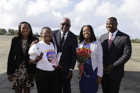 Secretary for Community Development, Enterprise Development and Labour Marslyn Melville-Jack, Calypso Rose, THA Chief Secretary Kelvin Charles, Secretary for Tourism, Culture and Transportation Nadine Stewart-Phillips, and Assistant Secretary for Community Development, Enterprise Development and Labour Shomari Hector smile while taking a photo at the ANR Robinson International Airport.
