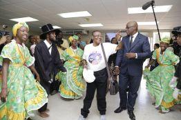 Dancers celebrate Calypso Rose as THA Chief Secretary Kelvin Charles looks on.