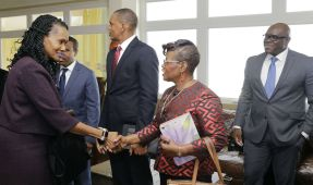 Labour Minister Jennifer Baptiste-Primus, left, shakes hands with CDB Portfolio Manager Dr Idamay Denny, prior to the start of the presentation. Also in photo, from left, are CDB Director, Economic, Dr Justin Ram (partially hidden), CDB Director, Projects, Daniel Best and CDB Economist Ronald James.
