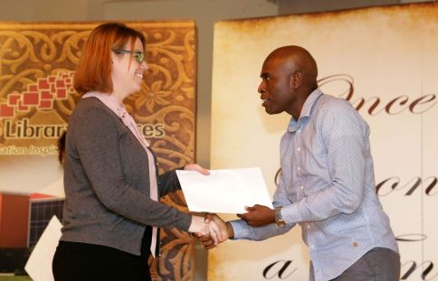 Literacy tutor Ellen Johnson receives a certificate of achievement from former THA Secretary for Education Huey Cadette at the Tobago Institute of Literacy's annual general meeting.