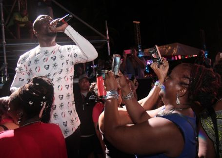 Hip hop star Wyclef Jean provides fans with a great photo opportunity as he gets closer to the audience in the general admission section.
