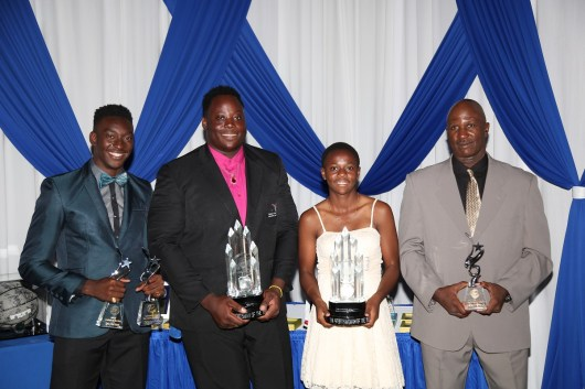 Coach of the Year, Wade Franklyn pose with his three winning athletes, Tyriq Horsford (Male Student Athlete of the Year), Akeem Stewart (Sportsman of the Year), Asha James (Sportswoman of the Year).