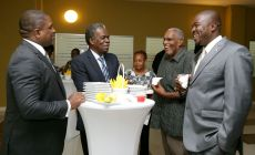 Deputy Chief Secretary Joel Jack, left, has a lively chat with fellow guests, including High Commissioner to the United Kingdom Orville London, second from left, and Secretary of Settlements, Urban Renewal and Public Utilities Clarence Jacob.