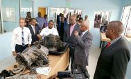 NESC Goldsborough campus manager Terrence Fraser, (third from left in foreground) shows THA Chief Secretary Kelvin Charles, next to him) and Minister o fEducation Anthony Garcia, second from right, the workshop of the new NESC skills center at Goldsborough. Looking on (in foreground) from left are NESC Director and ANSA Automotive Sector Head Jerome Borde, NESC president Kern Dass and Minister of State in the Ministry of Education Dr Lovell Francis, right.
