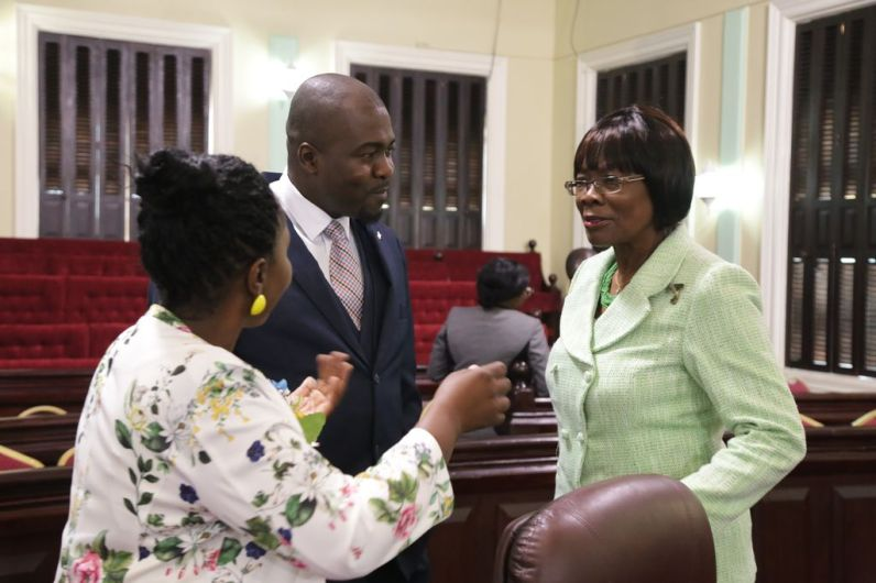 Secretary of Health Wellness, and Family Development Dr. Agatha Carrington, right, chats with Assistant Secretary in the Office of the Chief Secretary Marisha Osmond, left, and Secretary of Settlements, Urban Renewal and Public Utilities Clarence Jacob.