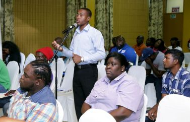An attendee asks a question during the session.