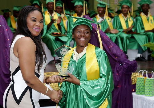 Tourism Minister and MP for Tobago West Shamfa Cudjoe, a past student, present Kymoi Noray with the most outstanding all round student award. Noray also received an award for the most outstanding sport student and the Concrete Rose award for female student which Cudjoe sponsors.