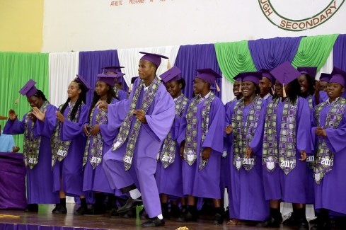 Roxborough Secondary School graduates sing Michael Jackson's Man In The Mirror as the graduates song at the end of the programme.