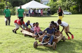 These young villagers try out a pair of box carts.