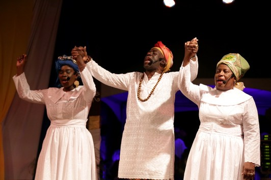"""From left, Petalia Alleyne-Bristol, Jesse Taylor and Deane Reid play the role of elders in the production """"Many Hands, One Legacy"""" at the Pembroke Heritage Park on Monday night."""