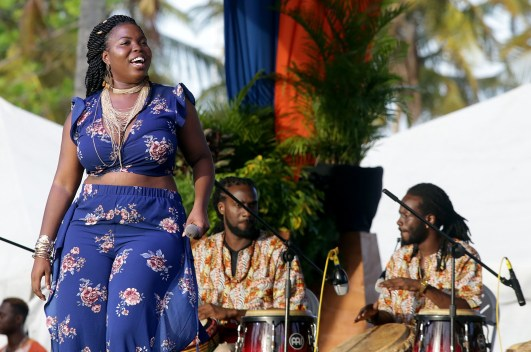 Singer Yolanda and Heartbeat drummers entertain the crowd.