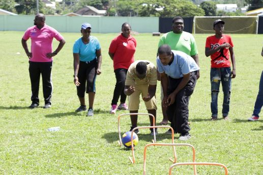 Coaches teach their newly learned skills with participants at the disability camp hosted by the Division of Sport and Youth Affairs at the Mt Pleasant Recreation Grounds prior to the closing of the programme on Friday (August 4, 2017).
