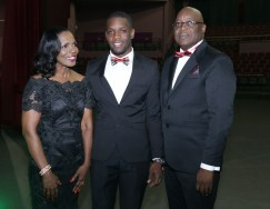 Chief secretary Kelvin Charles, right, his wife Catherine and son Kelvon Charles take a photo during the event.
