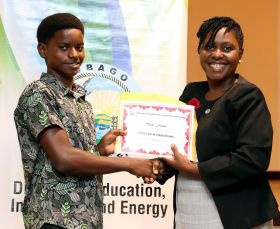 Assistant Secretary in the Education Division Marisha Osmond presents Tevin Fraser with a certificate of participation.