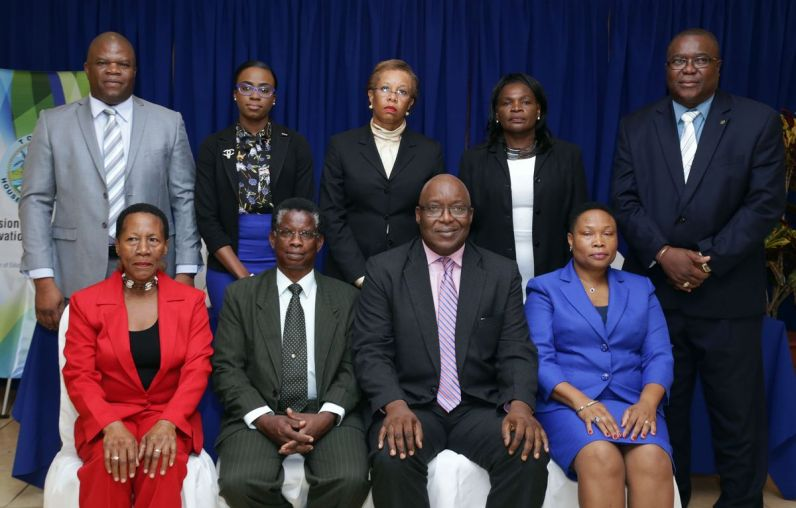 In group photo standing from left are: Carlos Waldron, Danelle De Coteau, Dr Levis Guy-Obiakor, Shirley Cooke and Michael Simmons. Seated front are Agnes Murray, Chairman Dr Alison Williams, Chief Secretary Kelvin Charles and Deanne Whiskey-John.