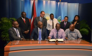 THA Chief Administrator Raye Sandy, second from right, front row, signs the memorandum of agreement between the Tobago House of Assembly, Mt. Pleasant Credit Union and the Water and Sewerage Authority. Also in photo are, from left, front row, WASA Chairman Romney Thomas, Chief Secretary Kelvin Charles, Chief Administrator Raye Sandy and president of Mt. Pleasant Credit Union Winford James. Back row, from left, are WASA CEO Dr. Ellis Burris, WASA Deputy Chairman Richard Jones, THA Senior Legal Consultant Alvin Pascal, WASA General Counsel and Corporate Secretary Dion Abdool and attorney-at-law for Mt. Pleasant Credit Union, Giselle Sampson.