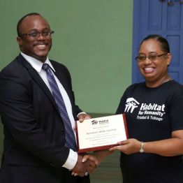 Republic Bank Tobago manager Shedley Branche, left, receives an appreciation award from Habitat for Humanity's national director, Jennifer Massiah.