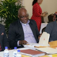 Chief Secretary Kelvin Charles, second from left, shares a light moment with Secretary of Finance and the Economy Joel Jack, left. Also in photo are acting Chief Administrator Claire Davidson-Williams.