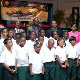 Students of the Bon Accord Government School's 4H Club share a photo opportunity with THA Secretaries following the opening ceremony of the World Food Day Programme at the Anne Mitchell Gift Auditorium of the Scarborough Library Facility.
