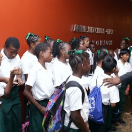 Chief Secretary Kelvin Charles, left, chats with students of the Bon Accord Government school's 4H club who attended the opening ceremony of the World Food Day programme.