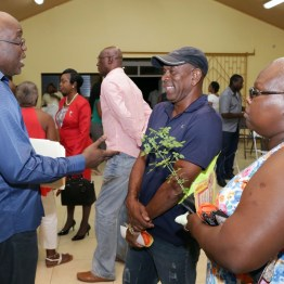Villagers chat with Chief Secretary Kelvin Charles following the meeting.