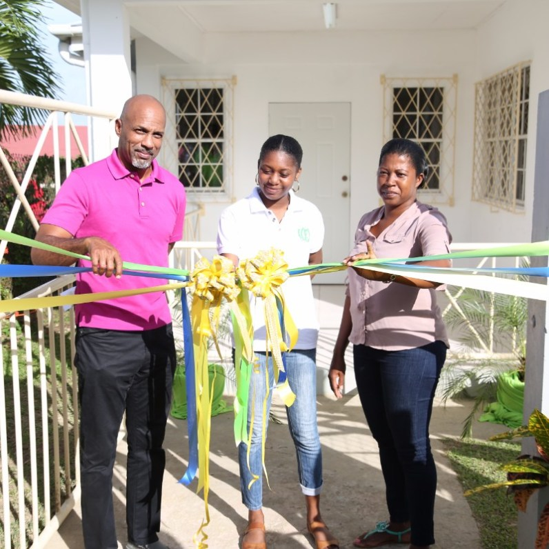 Secretary for Sport and Youth affairs Jomo Pitt, Youth Representative Sherice Elliot from the Patience Hill Prison Youth Club and Village Council President, Nicole Sobers cut the ribbon to declare open the Signal Hill Youth Centre on Friday 13th, 2017.