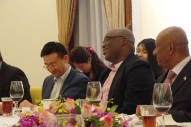 THA Chief Secretary Kelvin Charles shares a joke with Deputy Director General of Guangdong Foreign Affairs Cang Feng, left, and His Excellency Ambassador of Guyana to China Hayley Karran.