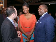 High Commissioner Tim Stew chats with Deputy Chief Secretary Joel Jack and his wife Dr Kamaria Keens Dumas-Jack.