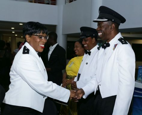 TTPS Acting Assistant Commissioner Garfield Moore greets Senior Superintendent Joan Archie on her arrival to the concert.