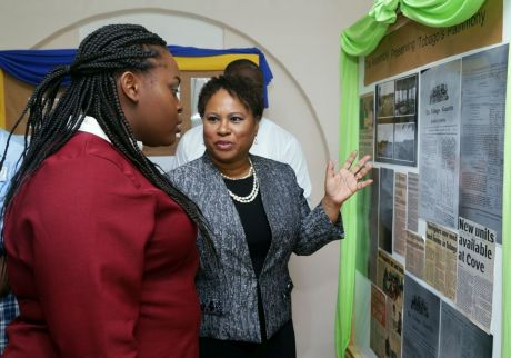 Presiding Officer Denise Tsoiafatt-Angus chats with Jessica Forbes, who performed the role of the presiding officer in the Junior Assembly, as they look at items on display at the Tobago Day exhibit in the Legislature building.