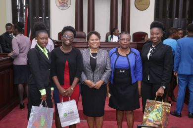 The prize winners from left, third placed Kershel Pierre, winner Kezia Franco, Presiding Officer Dr Denise Tsoiafatt Angus, Clerk of the Assembly Sharon Irvine-Combie, and second placed Mahkees Henry.