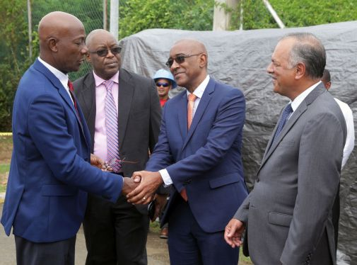 Prime Minister Dr Keith Rowley, left, greets Public Utilities Minister Robert Le Hunte as Chief Secretary Kelvin Charles, second from left and T&TEC chairman Keith Sirju look on.