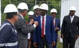 T&TEC chairman Keith Sirju chats with PM Dr Keith Rowley. Others from left are Project Director of LS Energia Inc German Valderrama, Chief Secretary Kelvin Charles, Public Utilities Minister Robert Le Hunte and Secretary of Settlements, Urband Renewal and Public Utilities Clarence Jacob.