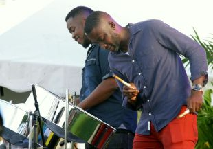 Pannists, left, Leandro Noray and Ryan Mc Kellar entertain with a melodic performance.